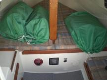 v-berth forward (sails in bags: main, 110 jib and 150 genoa); electrical panels, galley to part and 1/4-berth to starboard.