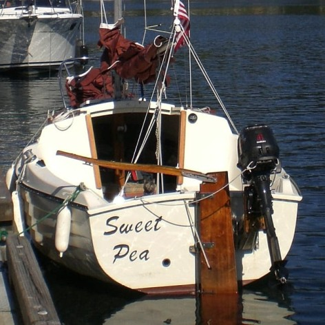 At the public dock at Gig Harbor, WA. Look closely under the tiller and you can see Momma Kitty!